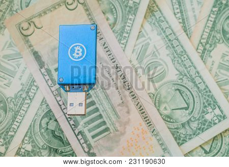 Blue Thumb Drive Usb Bitcoin Miner On Top Of Stack Of American Money