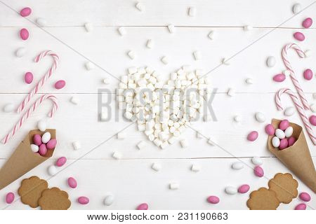Frame Colorful Candies, Striped Lollipops, Cookies And Marshmallows In The Form Of Heart Top View Wh