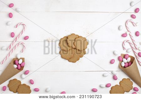 Frame Colorful Candies, Striped Lollipops And Cookies Top View White Wooden Background Valentines Da
