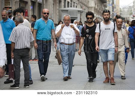 Istanbul Turkey 05 July 2017 People At Istiklal. Men Of Different Ages Walk Down The Street