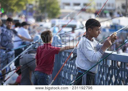 Istanbul Turkey 05 July 2017 Fishmen On The Galata Bridge In Istanbul