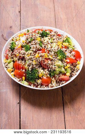 Quinoa Salad With Tomatoes , Avocado , Broccoli And Corn . Vegan Superfood