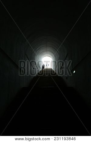 Dark Tunnel With The Silhouette People In The Future