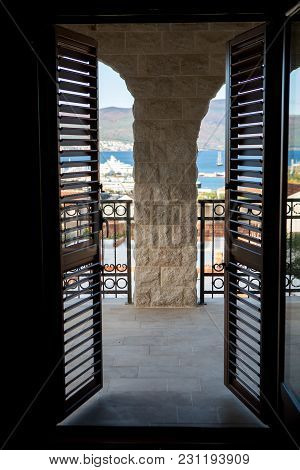 Doors With Wooden Blinds On The Window On A Large Balcony In Montenegro