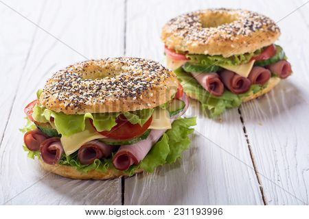 Bagels With Ham , Tomato And Salad . Traditional American Food