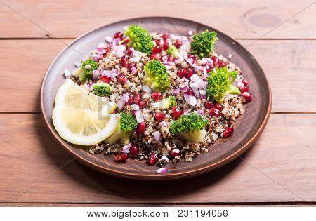 Quinoa Salad With Pomegranate , Broccoli And Onion