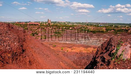 Open coal mining pit with heavy machinery in Kryvyi Rih, Ukraine.