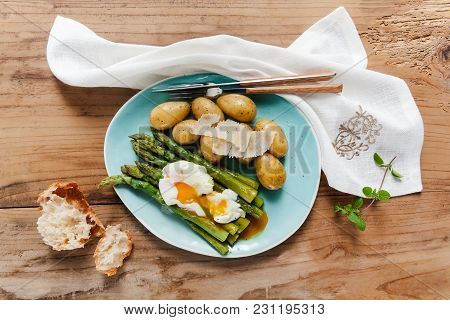 Light Spring Lunch On The Plate. Fried Asparagus, Fresh Potatoes And Poached Egg With Parmesan Chees
