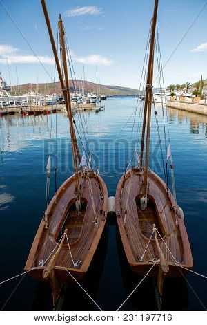 Two Brown Wooden Small Sailing Boats In Tivat Port