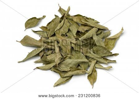 Heap of dried curry leaves isolated on white background