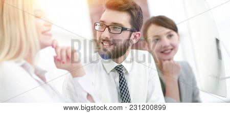 business team talking while sitting at your Desk.