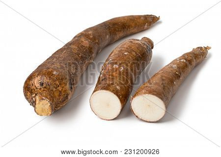 Whole Cassava root and two parts isolated at  white background