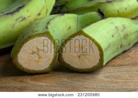 Half fresh green unripe bananas