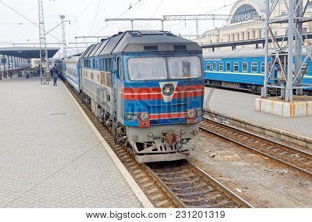 Kharkiv, Ukraine - March 25, 2012: Passenger Train Near The Platform Of The Kharkiv Passenger Railwa