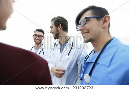 group of doctors advising the patient