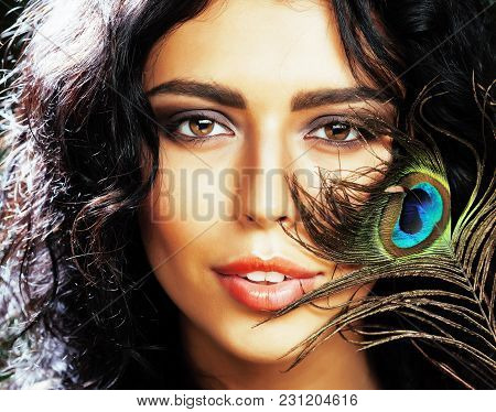 Young Sensitive Brunette Woman With Peacock Feather Eyes Close Up On Green Smiling, Lifestyle People