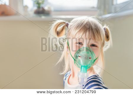 Happy Smiling Kid Using Nebuliser Mask. Inhalation Therapy Curing Chest Cold And Coughing. Healthcar