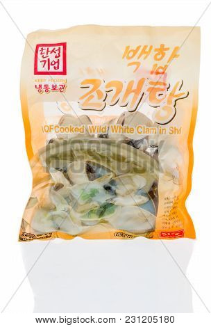 Winneconne, Wi -6 March 2018: A Bag Of Iqf Cooked Wild White Clam In Shell On An Isolated Background