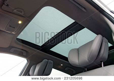 Car Sunroof With Rain Drops, From Inside