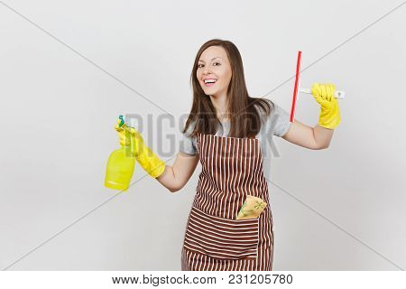 Young Smiling Housewife In Yellow Gloves, Striped Apron, Cleaning Rag In Pocket Isolated On White Ba