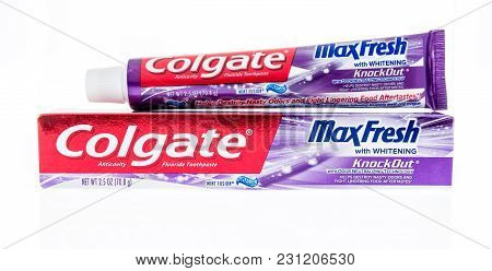 Winneconne, Wi - 9 March 2018: A Package Of Colgate Max Fresh Tooth Paste On An Isolated Background.