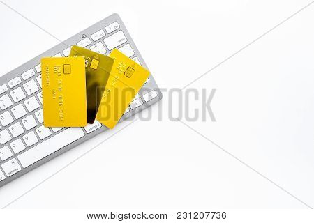 Electronic Payments. Bank Cards Near Keyboard Of Computer On White Background Top View.