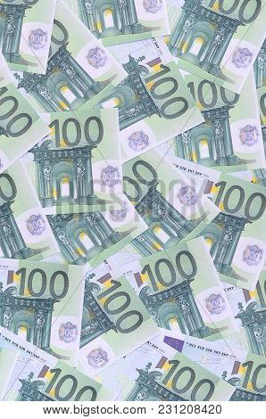 Background Pattern Of A Set Of Green Monetary Denominations Of 100 Euros. A Lot Of Money Forms An In