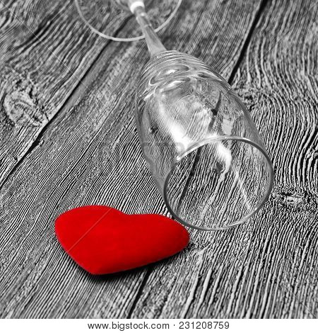 The Concept Of Harm Of Alcohol To Health And Family. Black And White Background, Red Heart And Empty