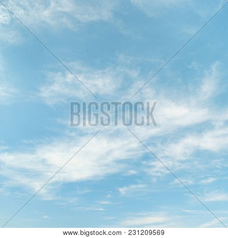 Cirrus clouds on light blue sky background.