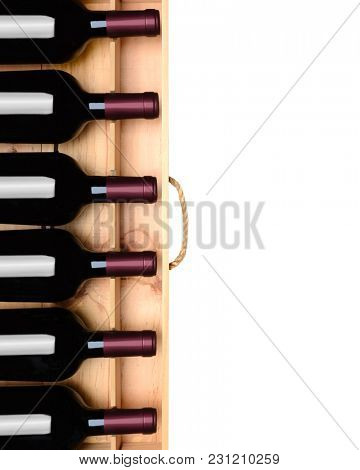 Wine crate with six bottles without labels. Horizontal format on white with copy space.