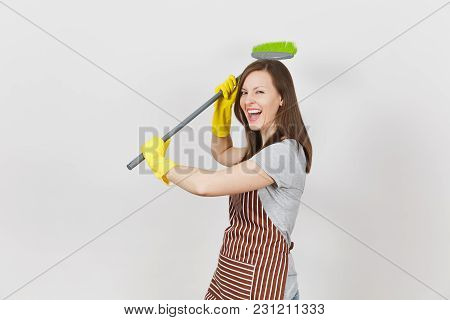 Young Smiling Housewife In Striped Apron, Yellow Gloves Isolated On White Background. Fun Housekeepe