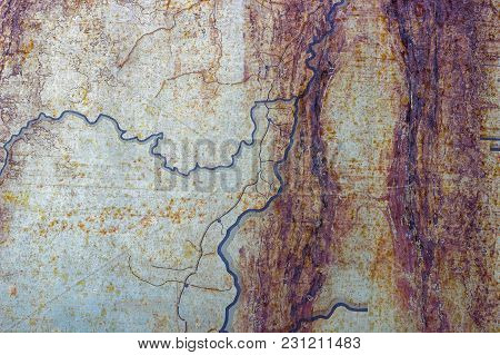 Metallic Rusted Painted Surface With Corrosion And Blue Lines As Texture Or Background. Thin Metal P