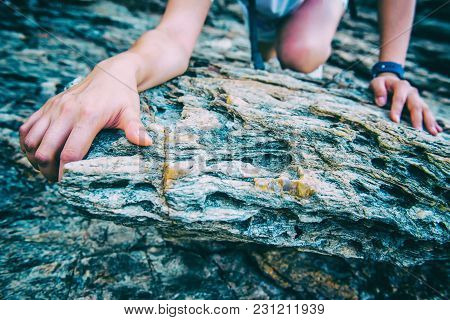 Sporty Woman Climbing On The Cliff. Success And Goal Concept. Strong And Healthy For Outdoor Activit