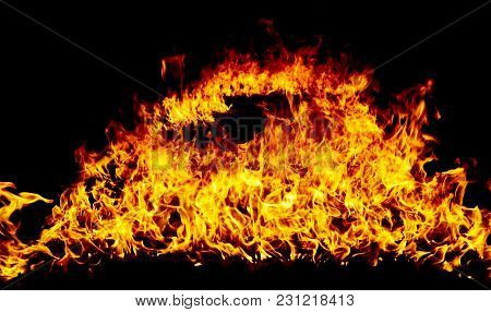 Hot Fire Flames On A Black Background