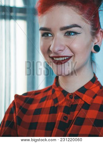 Beautiful girl with pretty smile laughing in pinup style.