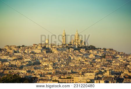 View Of Montmartre Hill And The Basilica Of The Sacred Heart Of Paris At Sunset, France, Europe