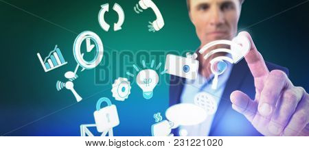 Businessman pressing an invisible virtual screen against green background with vignette