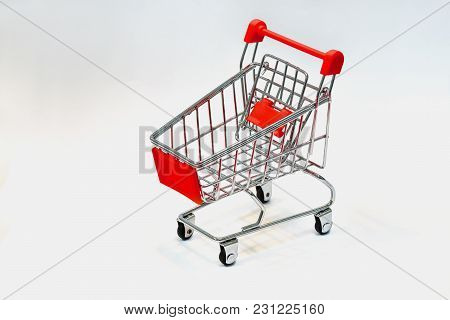 Close The Grocery Store In The Supermarket And Push The Shopping Cart With The Red Handle Isolated F