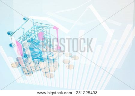 Double Exposure Stack Of Coins And Shopping Cart Or Supermarket Trolley With Financial Graph, Busine