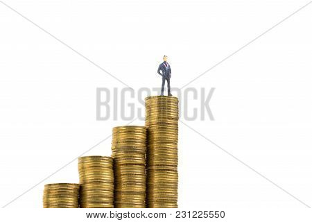 Figure Miniature Businessman Or Small People Standing On The Top Stack Of Coin Isolated On White Bac
