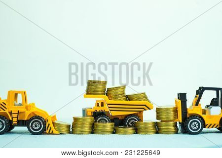 Mini Forklift Bulldozer Truck And Road Roller Machine With Pile Of Gold Coin, With Copy Space, Busin