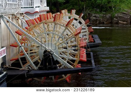 Taylors Falls, Mn/usa - May 29, 2017: The Wheels Of A Paddleboat On The St. Croix River Docked At Ta
