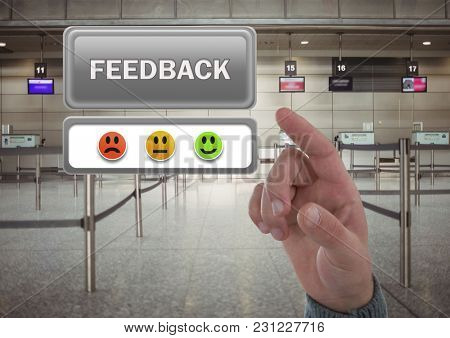 Digital composite of Hand pointing at feedback button and smiley faces review in airport