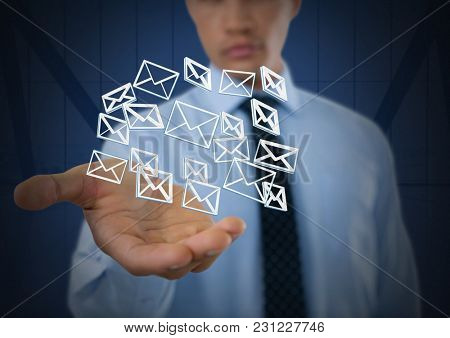 Digital composite of Email message app icons and Businessman with hands palm open and dark background