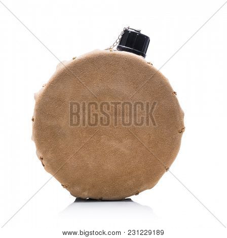 Vintage portable round water hip flask isolated on white background