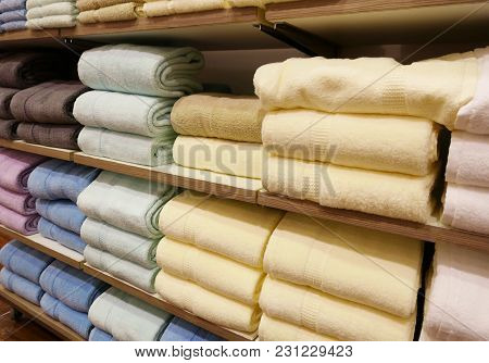 Piles Of Soft Towels On The Shelves