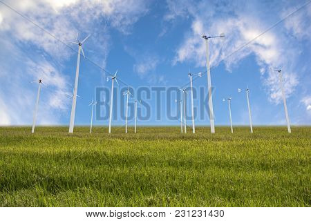 Group Of Wind Turbine In The Paddy Field.  Clean And Green Energy Concept.