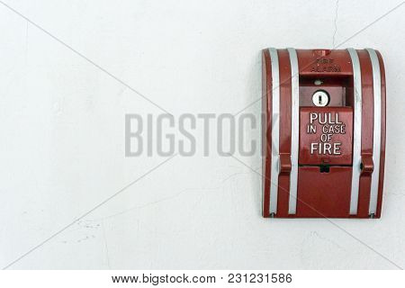 Fire Alarm On The White Wall At The Office Building.