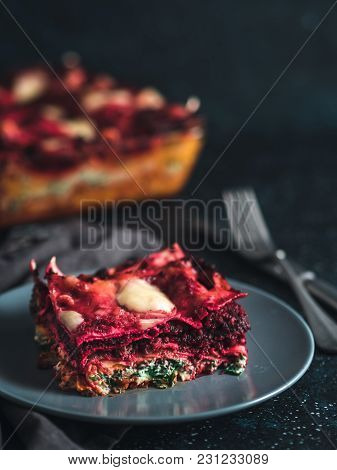 Vegetable Packed Rainbow Lasagne On Dark Background.ideas And Recipes For Healthy Vegetarian Dinner