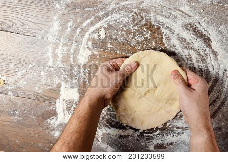 Male Hand Chef Close-up. Preparation Of Italian Food Pasta, Pizza Or Bread Focaccia. The Recipe For
